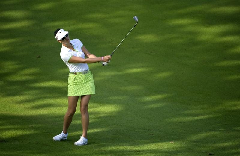 ROGERS, AR - SEPTEMBER 10:  Michelle Wie makes an approach shot during the first round of the P&G NW Arkansas Championship at the Pinnacle Country Club on September 10, 2010 in Rogers, Arkansas.  (Photo by Robert Laberge/Getty Images)