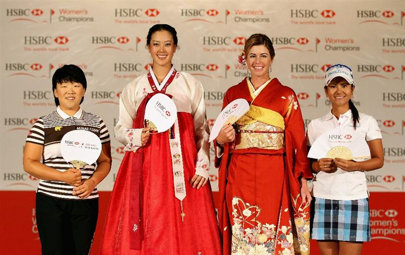 SINGAPORE - FEBRUARY 22:  (L-R) Jiyai Shin of South Korea; Michelle Wie of the USA; Paula Creamer of the USA; Ai Miyazato of Japan pose for pictures during a photocall at the Fairmont Hotel prior to the start of the HSBC Women's Champions at the Tanah Merah Country Club on February 22, 2011 in Singapore.  (Photo by Andrew Redington/Getty Images)