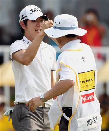 KUALA LUMPUR, MALAYSIA - MARCH 07:  Noh Seung-yul of Korea celebrates with his caddie on the 18th green after winning the Maybank Malaysian Open at the Kuala Lumpur Golf and Country Club on March 7, 2010 in Kuala Lumpur, Malaysia.  (Photo by Andrew Redington/Getty Images)