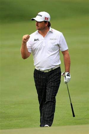 PONTE VEDRA BEACH, FL - MAY 15:  Graeme McDowell of Northern Ireland reacts to making birdie on the tenth hole during the continuation of the third round of THE PLAYERS Championship held at THE PLAYERS Stadium course at TPC Sawgrass on May 15, 2011 in Ponte Vedra Beach, Florida.  (Photo by Streeter Lecka/Getty Images)