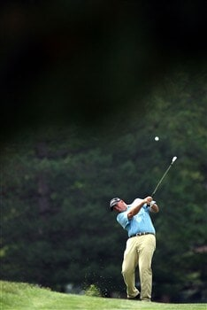 GRAND BLANC, MI - JUNE 26:  Tom Lehman hits out of the fairway on the eigth hole during the first round at the Buick Open at Warwick Hills Country Club on June 26, 2008 in Grand Blanc, Michigan. (photo by Marc Serota/ Getty Images)