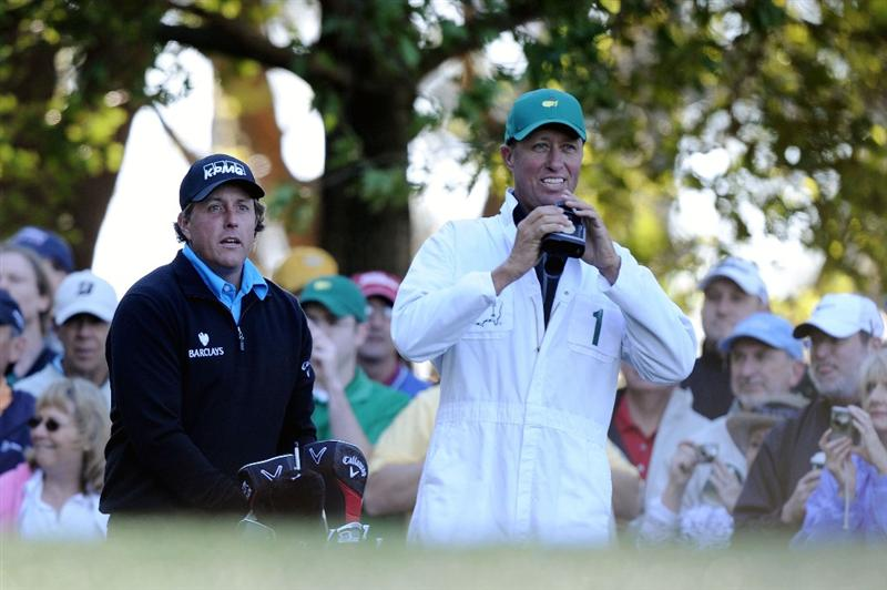 AUGUSTA, GA - APRIL 06:  Phil Mickelson waits on a tee box with his caddie Jim Mackay during a practice round prior to the 2011 Masters Tournament at Augusta National Golf Club on April 6, 2011 in Augusta, Georgia.  (Photo by Harry How/Getty Images)