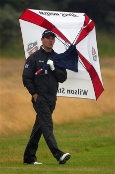 SOUTHPORT, UNITED KINGDOM - JULY 17:  Padraig Harrington of Ireland walks under an umbrella on the 1st hole during the First Round of the 137th Open Championship on July 17, 2008 at Royal Birkdale Golf Club, Southport, England.  (Photo by Andrew Redington/Getty Images)