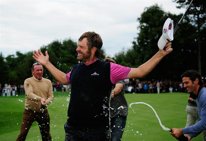 VIENNA, AUSTRIA - SEPTEMBER 19:  Jose Manuel Lara of Spain celebrates winning as he is sprayed with champagne by countrymen Miguel Angel Jimenez and Carlos Rodiles during the final round of the Austrian golf open presented by Botarin at the Diamond country club on September 19, 2010 in Atzenbrugg near Vienna, Austria.  (Photo by Stuart Franklin/Getty Images)