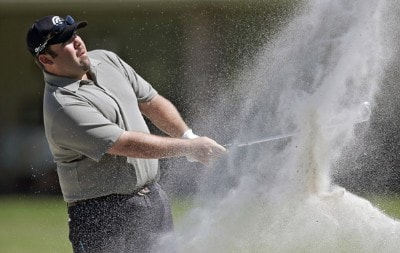 Kevin Stadler blasts out of the bunker during the third round of the Chitimacha Louisiana Open at Le Triomphe Country Club in Broussard, Louisiana,on Saturday, March 25, 2006.Photo by Drew Hallowell/WireImage.com