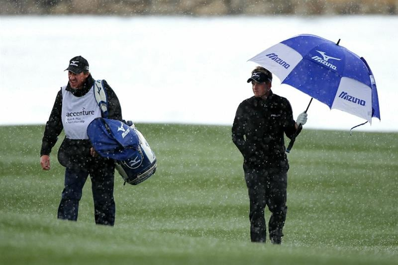 MARANA, AZ - FEBRUARY 27:  Luke Donald of England (R) holds an umbrella as he walks up the fourth fairway with his caddie John McLaren (L) when poor weather hit causing a subsequent delay during the final round of the Accenture Match Play Championship at the Ritz-Carlton Golf Club on February 27, 2011 in Marana, Arizona.  (Photo by Andy Lyons/Getty Images)