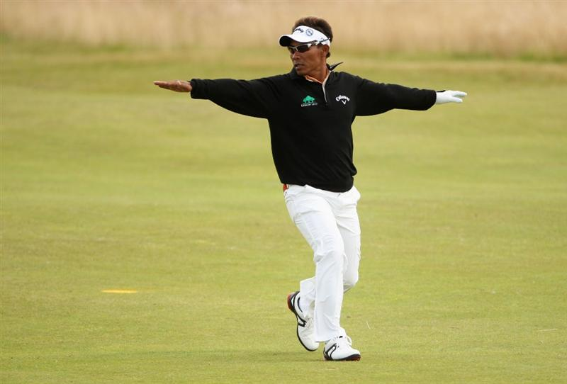 TURNBERRY, SCOTLAND - JULY 18:  Thongchai Jaidee of Thailand pretends to fly on the 14th hole during round three of the 138th Open Championship on the Ailsa Course, Turnberry Golf Club on July 18, 2009 in Turnberry, Scotland.  (Photo by Andrew Redington/Getty Images)