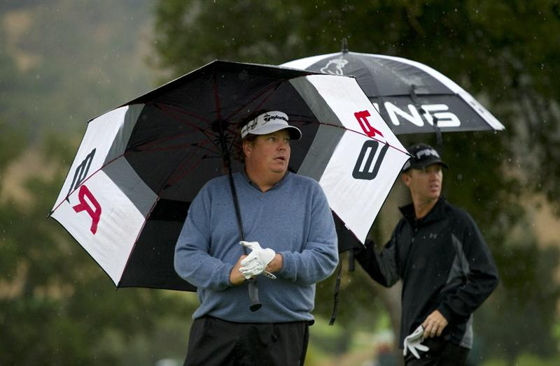 SAN MARTIN, CA - OCTOBER 17:  Tim Herron (left) gets ready for his tee shot on the second hole as Chris Riley looks on during the final round of the Frys.com Open at the CordeValle Golf Club on October 17, 2010 in San Martin, California.  (Photo by Robert Laberge/Getty Images)