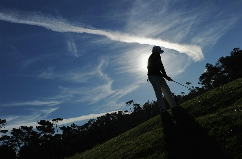 PEBBLE BEACH, CA - FEBRUARY 12:  Nick Watney plays his approach shot on the first hole during the third round of the AT&T Pebble Beach National Pro-Am at the Spyglass Hil Golf Course on February 11, 2011  in Pebble Beach, California  (Photo by Stuart Franklin/Getty Images)
