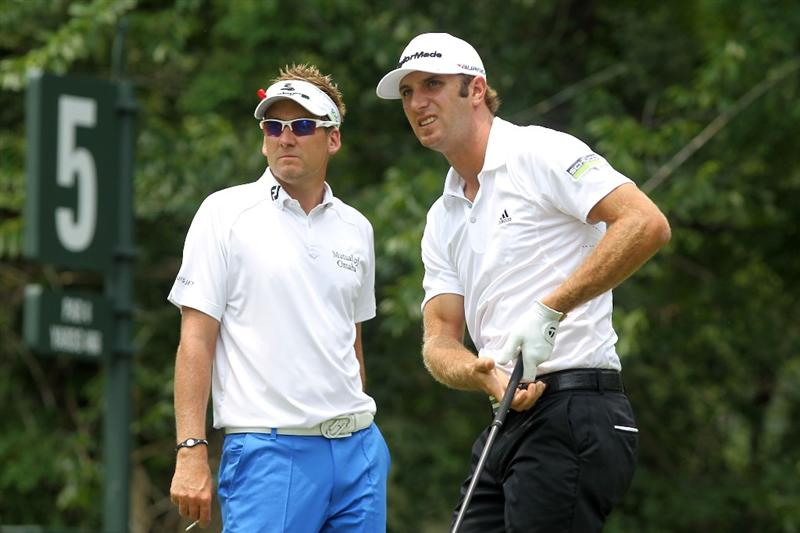 PONTE VEDRA BEACH, FL - MAY 14:  Ian Poulter of England (L) and Dustin Johnson (R) look on from the fifth hole tee box during the third round of THE PLAYERS Championship held at THE PLAYERS Stadium course at TPC Sawgrass on May 14, 2011 in Ponte Vedra Beach, Florida.  (Photo by Scott Halleran/Getty Images)