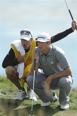 PEBBLE BEACH, CA - JUNE 19:  Dustin Johnson and his caddie Bobby Brown line up a putt on the fourth hole during the third round of the 110th U.S. Open at Pebble Beach Golf Links on June 19, 2010 in Pebble Beach, California.  (Photo by Donald Miralle/Getty Images)