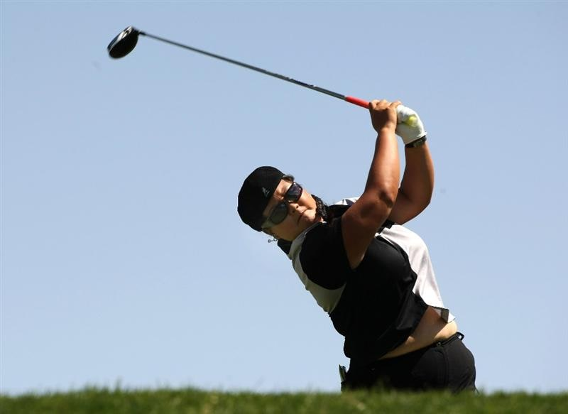 RANCHO MIRAGE, CA - APRIL 3:  Christina Kim hits her tee shot on the 11th hole during the second round of the Kraft Nabisco Championship at Mission Hills Country Club on April 3, 2009 in Rancho Mirage, California.  (Photo by Stephen Dunn/Getty Images)