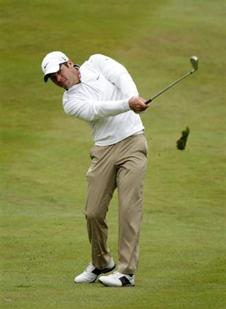 VIRGINIA WATER, ENGLAND - MAY 28:  Paul Casey of England hits an approach shot on the 7th hole during the third round of the BMW PGA Championship at the Wentworth Club on May 28, 2011 in Virginia Water, England.  (Photo by Ross Kinnaird/Getty Images)