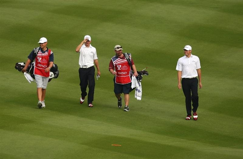 SHENZHEN, CHINA - NOVEMBER 26:  John Merrick and Nick Watney of USA during the Fourball on the first day of the Omega Mission Hills World Cup on the Olazabal course on November 25, 2009 in Shenzhen, China.  (Photo by Ian Walton/Getty Images)