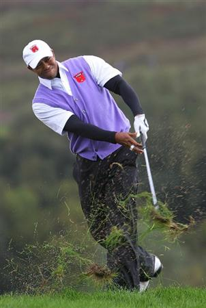 NEWPORT, WALES - OCTOBER 02:  Tiger Woods of the USA hits an approach shot on the 11th hole during the rescheduled Afternoon Foursome Matches during the 2010 Ryder Cup at the Celtic Manor Resort on October 2, 2010 in Newport, Wales.  (Photo by Jamie Squire/Getty Images)