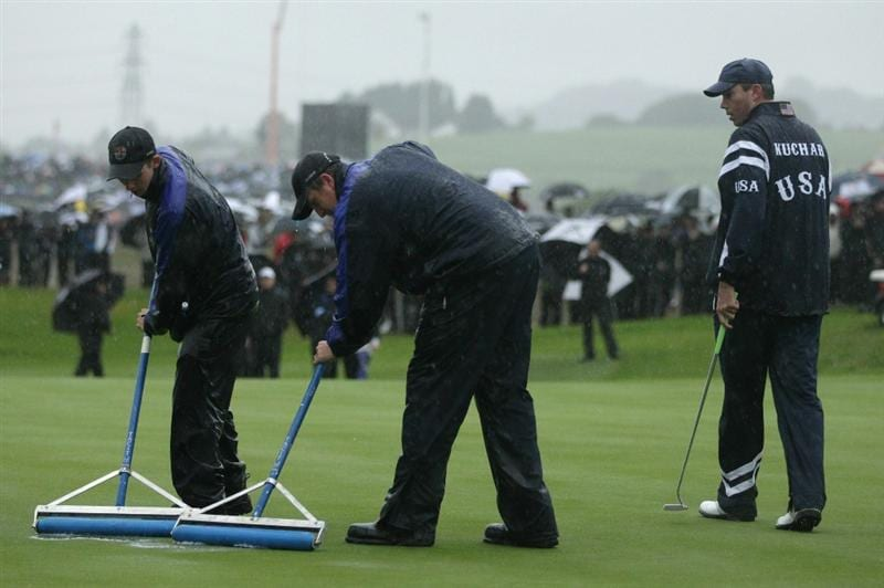 NEWPORT, WALES - OCTOBER 01:  Greenkeepers remove water from a green as rain falls during the Morning Fourball Matches during the 2010 Ryder Cup at the Celtic Manor Resort on October 1, 2010 in Newport, Wales.  (Photo by Andrew Redington/Getty Images)