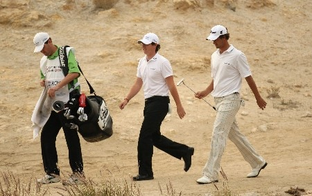 DOHA, QATAR - JANUARY 26:  Rory McIlroy of Northern Ireland and Adam Scott of Australia on the par three 17th hole during the third round of the Commercialbank Qatar Masters held at the Doha Golf Club on January 26, 2008 in Doha, Qatar.  (Photo by Ross Kinnaird/Getty Images)