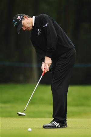 VIRGINIA WATER, ENGLAND - MAY 20:  Paul Lawrie of Scotland putts on the 1st hole during the first round of the BMW PGA Championship on the West Course at Wentworth on May 20, 2010 in Virginia Water, England.  (Photo by Ian Walton/Getty Images)