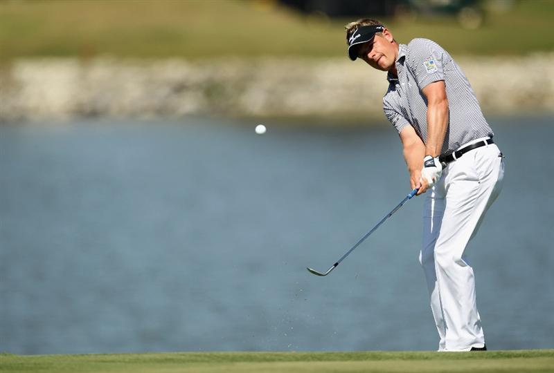 DORAL, FL - MARCH 13:  Luke Donald of England hits a shot on the fourth hole during the final round of the 2011 WGC- Cadillac Championship at the TPC Blue Monster at the Doral Golf Resort and Spa on March 13, 2011 in Doral, Florida.  (Photo by Mike Ehrmann/Getty Images)