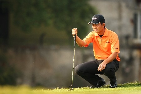 SHANGHAI, CHINA - NOVEMBER 08: Wen-chong Liang of China considers his putt on the 4th during Day 1 of the HSBC Champions at the Sheshan Golf Club on November 8, 2007 in Shanghai, China.  (Photo by Andrew Redington/Getty Images)