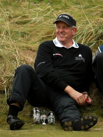 CARNOUSTIE, SCOTLAND - OCTOBER 09:  Colin Montgomerie of Scotland takes a break whilst he waits to play on the sixth tee during the third round of The Alfred Dunhill Links Championship at the Carnoustie Golf Links on October 9, 2010 in Carnoustie, Scotland.  (Photo by Andrew Redington/Getty Images)