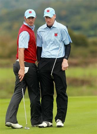 NEWPORT, WALES - OCTOBER 03:  Jim Furyk (R) of the USA lines up a putt with Dustin Johnson on the 9th green during the Fourball & Foursome Matches during the 2010 Ryder Cup at the Celtic Manor Resort on October 3, 2010 in Newport, Wales.  (Photo by Andrew Redington/Getty Images)