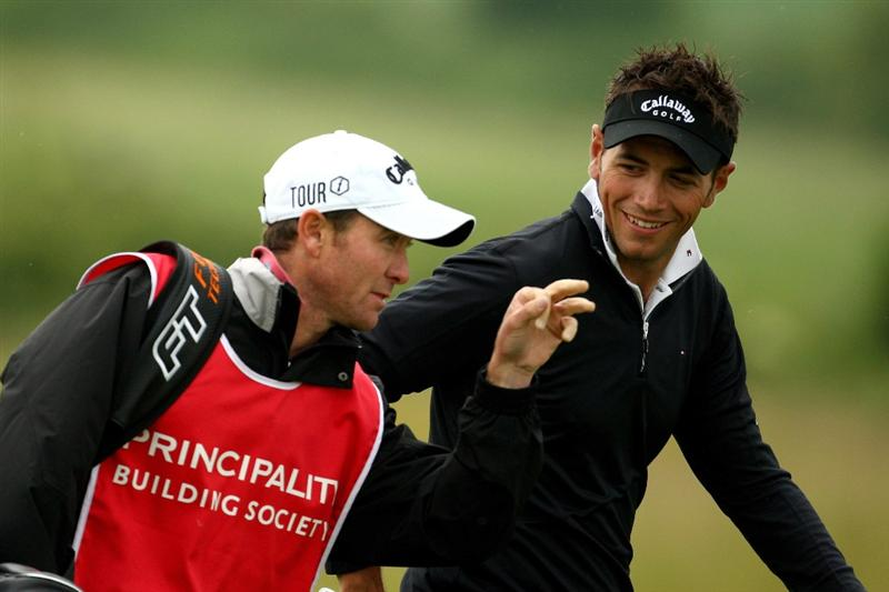 NEWPORT, WALES - JUNE 06:  Nick Dougherty of England talks with his caddy Michael Kerr during the third round of the Celtic Manor Wales Open on the 2010 Course at The Celtic Manor Resort on June 6, 2009 in Newport, Wales.  (Photo by Richard Heathcote/Getty Images)