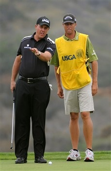 SAN DIEGO - JUNE 14:  Phil Mickelson chats with his caddie Jim Mackay on the third green during the third round of the 108th U.S. Open at the Torrey Pines Golf Course (South Course) on June 14, 2008 in San Diego, California.  (Photo by Harry How/Getty Images)