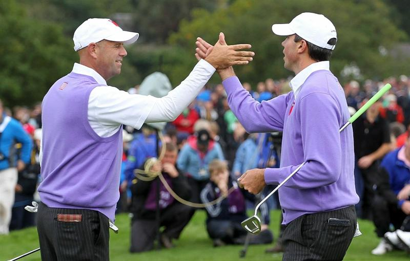 NEWPORT, WALES - OCTOBER 02:  Stewart Cink (L) and Matt Kuchar of the USA celebrate on the 2nd green during the rescheduled Afternoon Foursome Matches during the 2010 Ryder Cup at the Celtic Manor Resort on October 2, 2010 in Newport, Wales. (Photo by Andy Lyons/Getty Images)