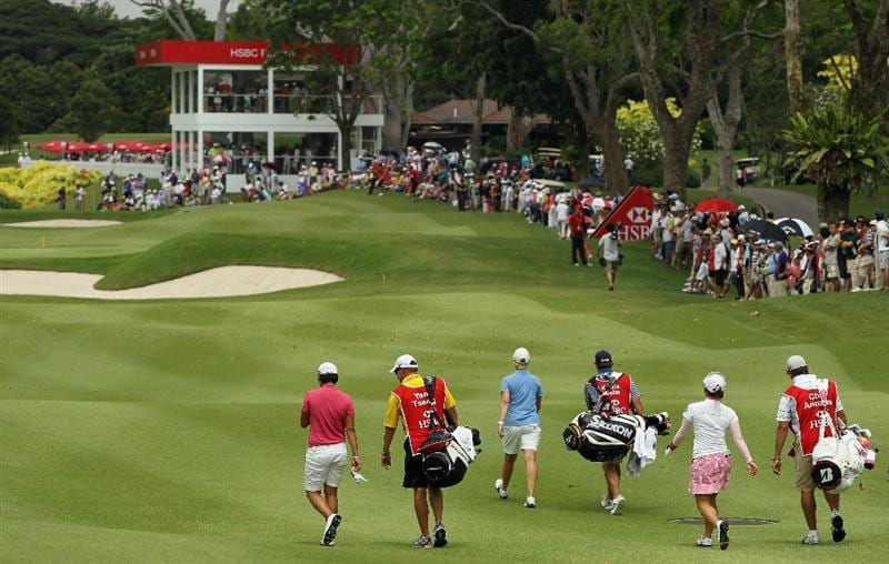 SINGAPORE - FEBRUARY 27:  The final group of (L-R) Yani Tseng, Karrie Webb and Chie Arimura walk off the eighth tee with their caddies during the final round of the HSBC Women's Champions 2011 at the Tanah Merah Country Club on February 27, 2011 in Singapore, Singapore.  (Photo by Scott Halleran/Getty Images)