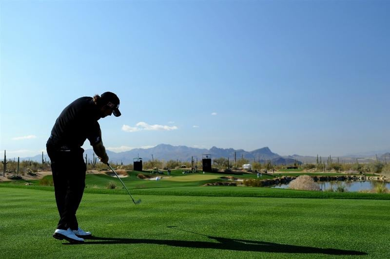 MARANA, AZ - FEBRUARY 24:  Graeme McDowell of Northern Ireland hits his tee shot on the third hole during the second round of the Accenture Match Play Championship at the Ritz-Carlton Golf Club on February 24, 2011 in Marana, Arizona.  (Photo by Stuart Franklin/Getty Images)