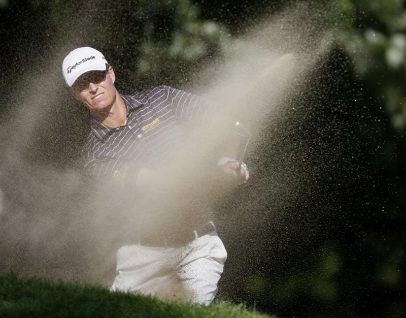 GRAND BLANC, MI - JULY 31:  John Senden from Australia hits out of a fairway bunker on the ninth hole during the second round of the Buick Open at Warwick Hills Golf and Country Club on July 31, 2009 in Grand Blanc, Michigan.  (Photo by Gregory Shamus/Getty Images)
