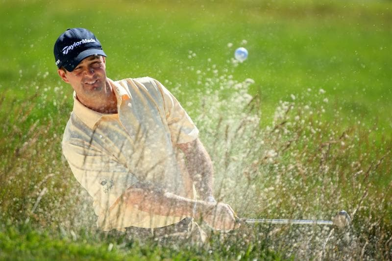 PEBBLE BEACH, CA - JUNE 16:  Charles Warren hits a bunker shot on the during a practice round prior to the start of the 110th U.S. Open at Pebble Beach Golf Links on June 16, 2010 in Pebble Beach, California.  (Photo by Donald Miralle/Getty Images)