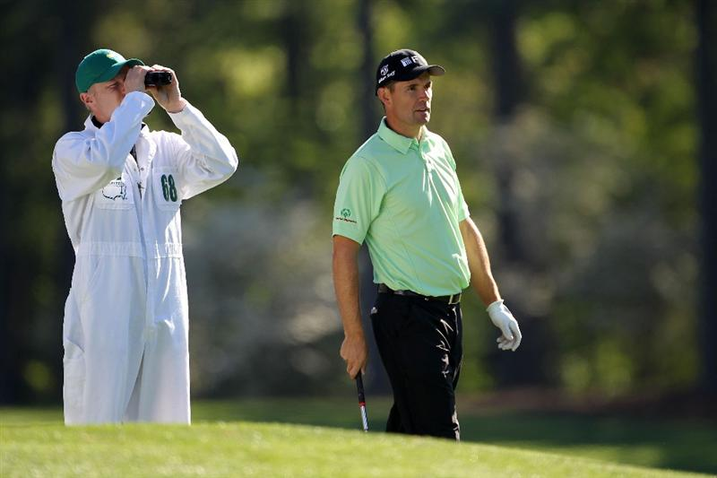 AUGUSTA, GA - APRIL 06:  Padraig Harrington of Ireland waits with his caddie Ronan Flood during a practice round prior to the 2011 Masters Tournament at Augusta National Golf Club on April 6, 2011 in Augusta, Georgia.  (Photo by Jamie Squire/Getty Images)