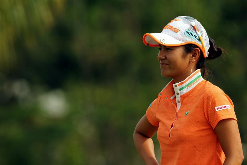 KUALA LUMPUR, MALAYSIA - OCTOBER 21:  Al Miyazato of Japan waits for her turn to tee off on the 10th hole during the Sime Darby Pro-Am at the KLGCC Golf Course on October 21, 2010 in Kuala Lumpur, Malaysia.  (Photo by Stanley Chou/Getty Images)