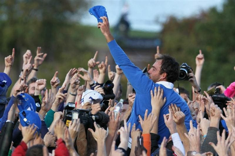 NEWPORT, WALES - OCTOBER 04:  Edoardo Molinari of Europe celebrates his team's victory with supporters at the end of the singles matches during the 2010 Ryder Cup at the Celtic Manor Resort on October 4, 2010 in Newport, Wales.  (Photo by Andy Lyons/Getty Images)
