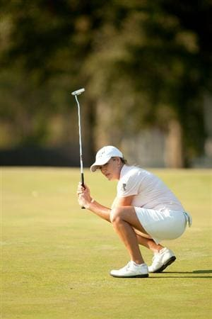 PRATTVILLE, AL - OCTOBER 10: Cristie Kerr reacts to a missed birdie putt at the 15th hole during the final round of the Navistar LPGA Classic at the Senator Course at the Robert Trent Jones Golf Trail on October 10, 2010 in Prattville, Alabama. (Photo by Darren Carroll/Getty Images)