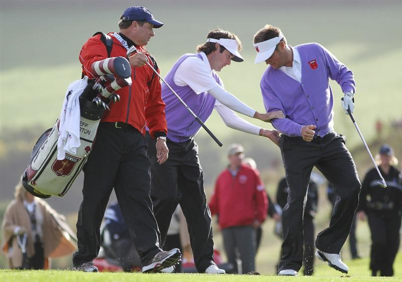 NEWPORT, WALES - OCTOBER 02:  Bubba Watson of the USA pats Jeff Overton on the backside on the 16th hole during the rescheduled Morning Fourball Matches during the 2010 Ryder Cup at the Celtic Manor Resort on October 2, 2010 in Newport, Wales. (Photo by Jamie Squire/Getty Images)