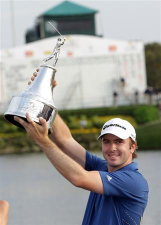 ORLANDO, FL - MARCH 27:  Martin Laird of Scotland proudly holds the trophy after the final round of the 2011 Arnold Palmer Invitational presented by Mastercard at the Bay Hill Lodge and Country Club on March 27, 2011 in Orlando, Florida.  (Photo by David Cannon/Getty Images)