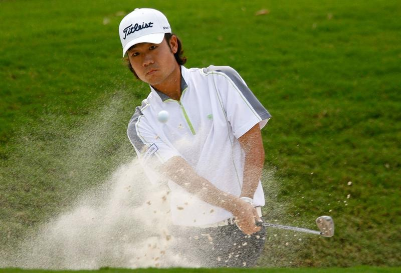 ATLANTA - SEPTEMBER 24:  Kevin Na plays a bunker shot on the first hole during the first round of THE TOUR Championship presented by Coca-Cola, the final event of the PGA TOUR Playoffs for the FedEx Cup, at East Lake Golf Club on September 24, 2009 in Atlanta, Georgia.  (Photo by Scott Halleran/Getty Images)
