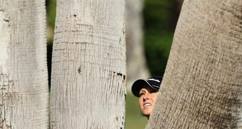 RANCHO MIRAGE, CA - APRIL 02: Natalie Gulbis of the USA in trouble behind big palm trees fro her third shot at the 12th hole during the first round of the 2009 Kraft Nabisco Championship, at the Mission Hills Country Club on April 2, 2009 in Rancho Mirage, California. (Photo by David Cannon/Getty Images)