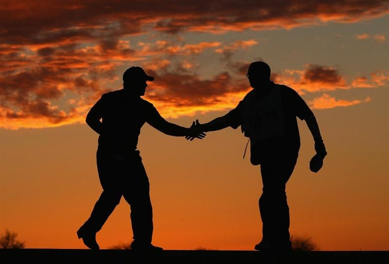 SCOTTSDALE, AZ - FEBRUARY 03:  Cameron Tringale (L) shakes hands with a caddie following his first round of the Waste Management Phoenix Open at TPC Scottsdale on February 3, 2011 in Scottsdale, Arizona.  (Photo by Christian Petersen/Getty Images)
