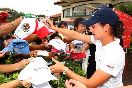 SINGAPORE - FEBRUARY 29:  Lorena Ochoa of Mexico signs autographs for fans after the third round of the HSBC Women's Champions at Tanah Merah Country Club on February 29, 2008 in Singapore.  (Photo by Scott Halleran/Getty Images)