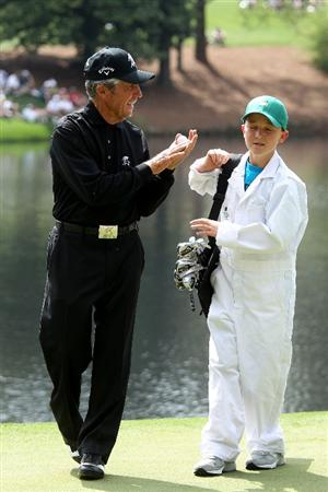 AUGUSTA, GA - APRIL 07:  Gary Player of South Africa talks with his caddie during the Par 3 Contest prior to the 2010 Masters Tournament at Augusta National Golf Club on April 7, 2010 in Augusta, Georgia.  (Photo by Andrew Redington/Getty Images)