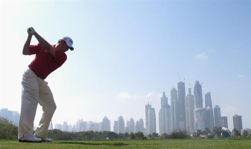 DUBAI, UNITED ARAB EMIRATES - FEBRUARY 10:  Lee Westwood of England hits his tee-shot on the eighth hole during the first round of the Omega Dubai Desert Classic on the Majlis course at the Emirates Golf Club on February 10, 2011 in Dubai, United Arab Emirates.  (Photo by Andrew Redington/Getty Images)