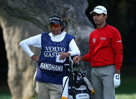 SOTOGRANDE, SPAIN - NOVEMBER 02:  Jyoti Randhawa of India waits with his caddie/cousin Bunty Randhawa on the 18th hole during the second round of the Volvo Masters at Valderrama Golf Club on November 2, 2007 in Sotogrande, Spain.  (Photo by Andrew Redington/Getty Images)