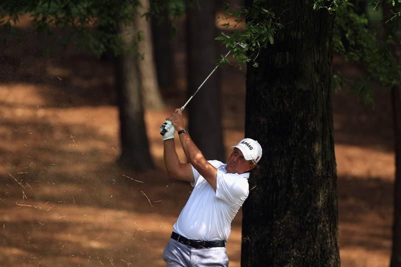 CHARLOTTE, NC - MAY 07:  Phil Mickelson hits from the rough on the 3rd hole during the third round of the Wells Fargo Championship at the Quail Hollow Club on May 7, 2011 in Charlotte, North Carolina.  (Photo by Streeter Lecka/Getty Images)