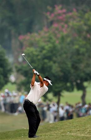 HONG KONG, CHINA - NOVEMBER 23:  Lin Wen - Tang of Taiwan plays his approach shot on the third hole during the final round of the UBS Hong Kong Open at the Hong Kong Golf Club on November 23, 2008 in Fanling, Hong Kong.  (Photo by Stuart Franklin/Getty Images)