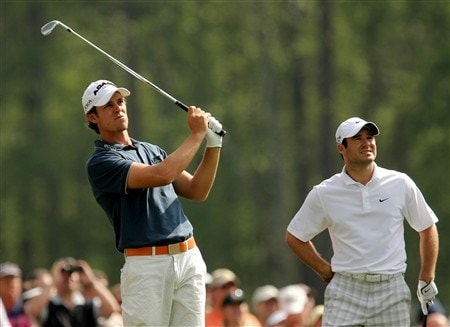 AUGUSTA, GA - APRIL 09:  Aaron Baddeley of Australia hits a shot as Trevor Immelman looks on during the third day of practice prior to the start of the 2008 Masters Tournament at Augusta National Golf Club on April 9, 2008 in Augusta, Georgia.  (Photo by Harry How/Getty Images)