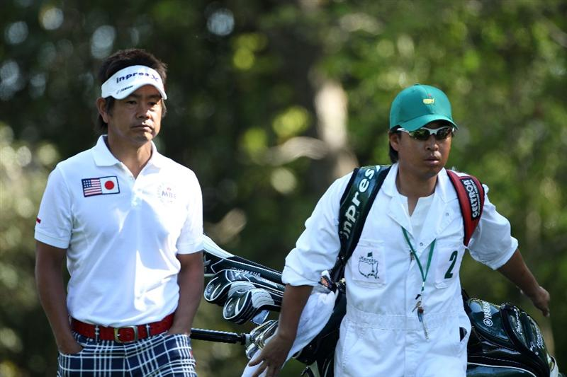 AUGUSTA, GA - APRIL 07:  Hiroyuki Fujita of Japan walks with his caddie Atsushi Umehara off the second tee during the first round of the 2011 Masters Tournament at Augusta National Golf Club on April 7, 2011 in Augusta, Georgia.  (Photo by Andrew Redington/Getty Images)